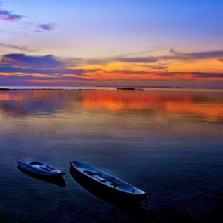 Picture of the sunset over the lagoon at Kura Kura Resort