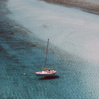 Picture of boat in beautiful waters Andros