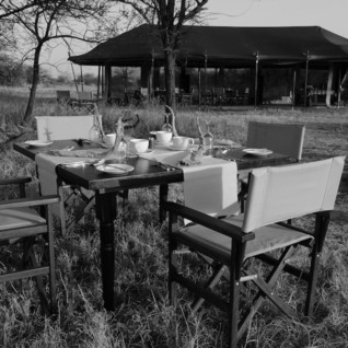 Outside dining at  Olakira Camp, luxury camp in Tanzania