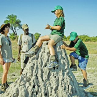 Family at a 'Dead' Termite Mound at Young Explorers Delta Safari Camp, luxury camp in Botswana