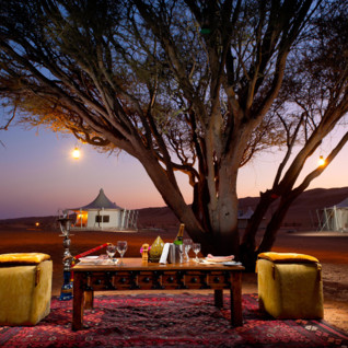Dining at Desert Night Camp, luxury hotel in Oman