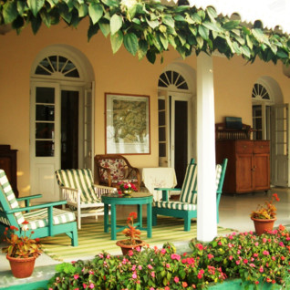 Verandah at Glenburn Tea Estate, luxury hotel in India