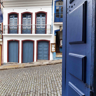 Blue Doorway to Cobbled Street