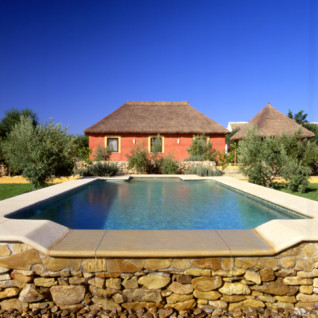Exterior with pool at Hacienda San Rafael, luxury hotel in Spain