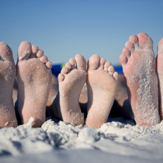 photo of feet in the sand