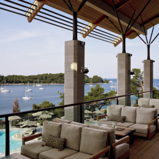 The terrace with ocean and pool views at Monte Mulini, luxury hotel in Croatia