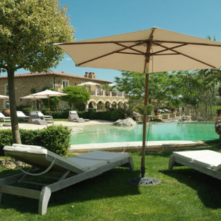 Pool area at Borgo Santo Pietro, luxury hotel in Italy