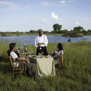 Private dining at Vumbura Plains Camp, luxury camp in Botswana