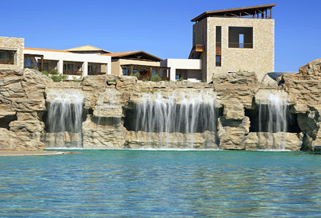 View of the pool, waterfalls and exterior of the building
