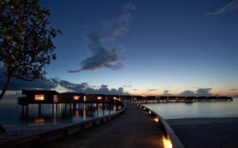 Villas at night at Park Hyatt Hadahaa, luxury hotel in the Maldives