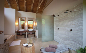 Picture of a beach villa bathroom, Desroches Island Resort