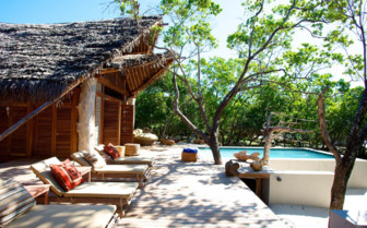 Picture of the view of the pool and deck at Vamizi Island Lodge