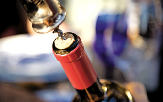 A Bottle of Wine being Uncorked