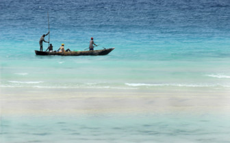 Picture of fishermen on a small boat in Mauritius