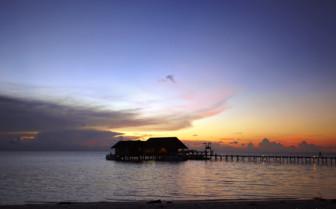 Sun setting behind the jetty at Lankayan