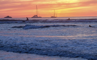 Nicoya Peninsula sunset and surfers