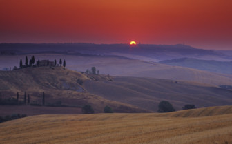 The sun rising over the hills in Italy