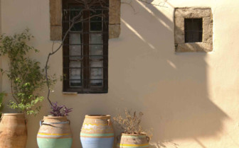 A Row of Pots against a Wall