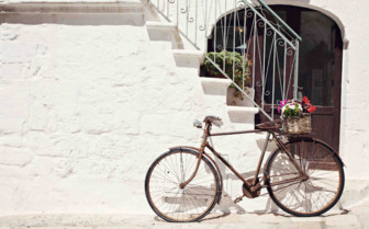 Bicycle propped by staircase
