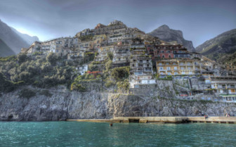 Imposing Positano with dark clouds