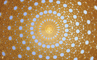 A Golden Mosque Ceiling Opening to Reveal Blue Sky