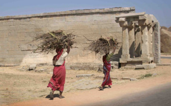 Women carrying branches