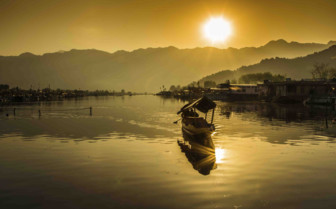 Sunrise over a boat in the lake