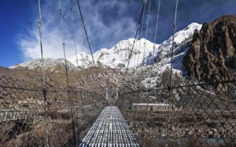 Bridge with snowy Himalaya backdrop