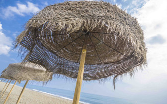 A Woven Beach Umbrella in Marbella