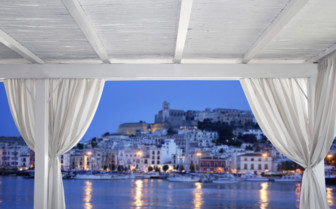A View of Ibiza at Night from a Covered Terrace