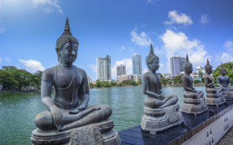 Buddhist statues on riverbank