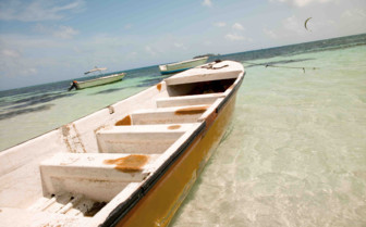 Boat in the Shallows of the Sea