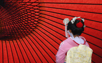 Geisha against red backdrop
