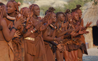 Namibian women sing and dance
