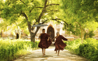 Monks running in Myanmar