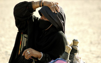 Bedouin woman in desert heat