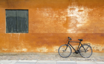 Bicycle against bright wall in Copenhagen