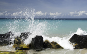 Waves Crashing into Rocks in Greanda