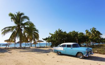 Classic cars by the beach, Cuba