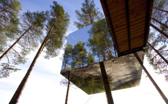 Mirror cube exterior at Treehotel, luxury hotel in Sweden