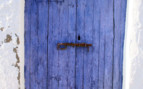 A Brightly Painted Blue Wooden Door in Spain