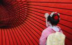 Geisha against red backdrop