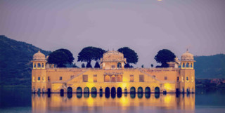 Building lit up on water in Rajasthan
