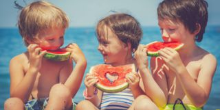 Children Eating Watermelon, European Beach